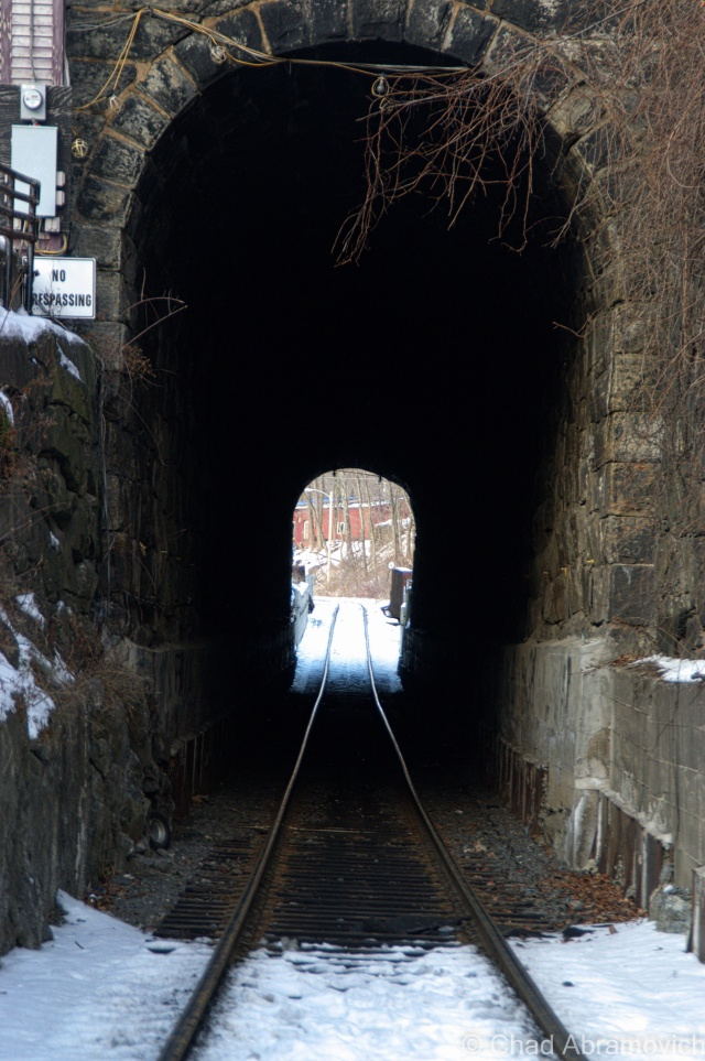One of my favorite finds in Bellows Falls – A 275-foot railroad tunnel running underneath a section of the downtown district. Built in 1851, this tunnel is a rather impressive reminder of when three railroad lines were brought through Bellows Falls, helping industrial growth and creating one of the most important railroad junctions in New England. What's striking about this tunnel is that its partially cut through solid rock and reinforced with massive stone blocks.