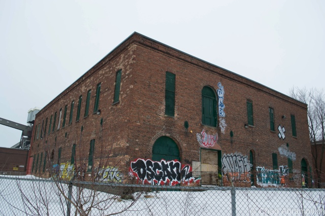 "Another great abandonment, most likely one of the original structures in the neighborhood. Surrounded by barbed wire fence and several ""keep out"" signs, this building successfully stands right out in the otherwise bland neighborhood, it's bright and creative graffiti creating a reward for wondering eyes."