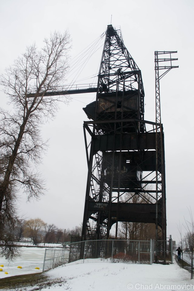 A large sight on an otherwise dull stretch of roadway, The LaSalle Coke Crane towers over the frozen dirty waters of the Lachine Canal. The rotting crane symbolizes the dependence the city's industry had on the canal. The crane was used for unloading coal arriving by boat to supply power for nearby factories.