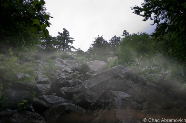 The Ice Beds at the base of the mountain, underneath thick mists that were beginning to settle deep in the rocky glens below the craggy summit. On dry summer days, the rocks provide a great place to climb around – something I have spent hours doing before. But not today. The rain that had began to fall had made the Quartzite boulders slippery and dangerous.