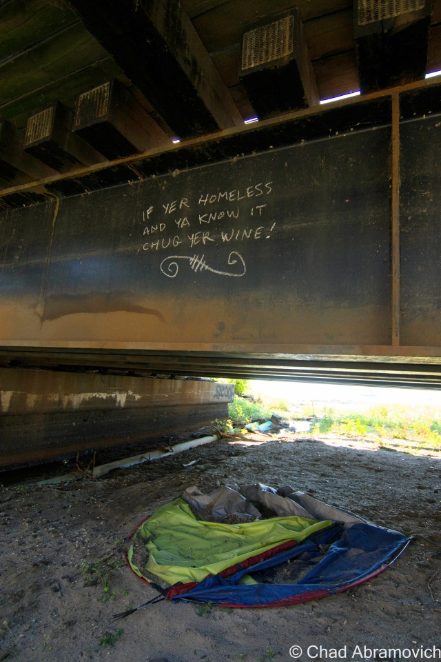 Homeless camps and salty graffiti under the bike path bridge