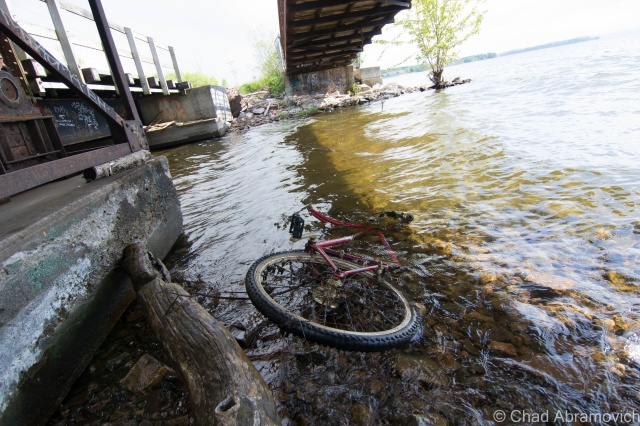 Under the barge canal bridge, where the canal meets the lake. A popular site for homeless camps, detritus and graffiti