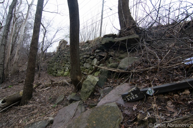 """On the hike back up, I found something sort of cool, what appeared to be an old stone retaining wall that holds up North Avenue from collapsing down into the dark pools below. The wall is most likely as old as when the road was first """"modernized"""", but I'm just assuming. Also located here was the BHS litter gardens - giving an incite into local culture and their eating habits."""