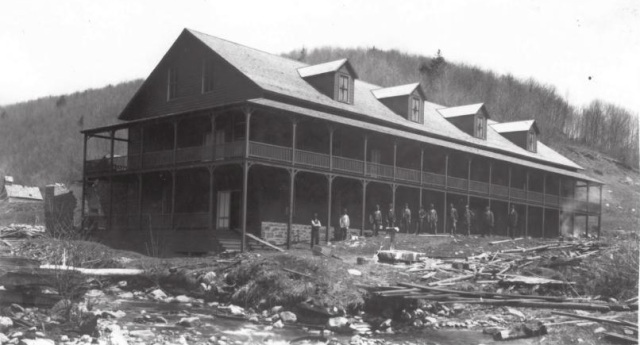 he Loggers Boarding House, and several residents posing for a photograph.