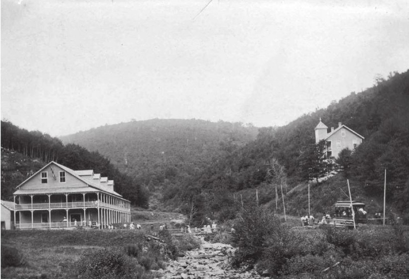 The village of South Glastenbury circa 1897. Bolles Brook is in the middle of the photo. The hotel (former logger's boardinghouse) is to the left, with the double story porch, and the casino (former company store), is up the hill a ways to the right. You can also see the electric trolly on the lower right hand corner of the photo - the same tracks we hiked to get up into town.
