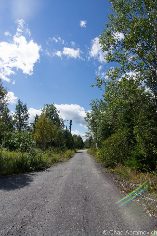 Radar Road, infront of the Quonset Village. Halfway up the mountain, the gravel road turned into pavement, which has surprisingly been left in good condition for being abandoned for over 40 years.