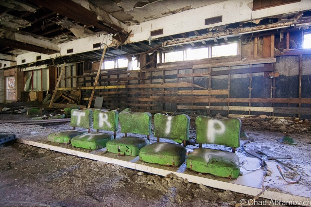 These 4 rotting bar stools are a photographic icon of this property. At one point, there were more of them, and they were all standing in a row lining the bar that they once accompanied. Today, only these 4 remain, barely.