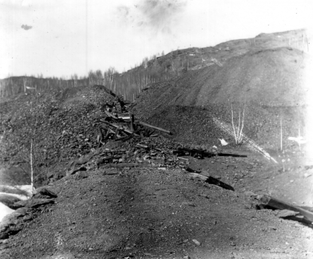 This photo from 1860 shows the extensive pollution from the mining operations; a wasteland of tailings piles, slag and wood scraps from older mine structures. | UVM Landscape Change Program
