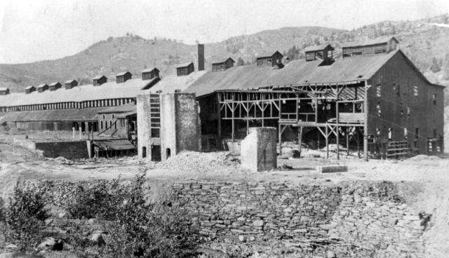 This is one of the smelting sheds at the Ely mine, taken around 1960, decades after it's abandonment, the wobbly structure still stands. | UVM Landscape Change Program.
