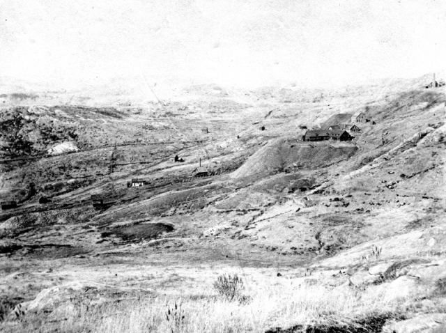 A view of the Ely mine, Copperfield and West Hill taken around 1900, after the mine's abandonment. The landscape is a barren and desolate one, devoid of vegetation. | UVM Landscape Change Program